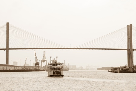 Riverboat coming under Talmadge Memorial Bridge in Savannah photo