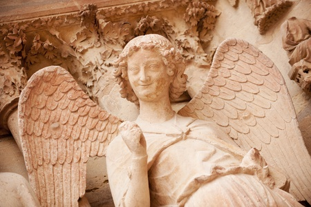 Famous smiling angel on facade of Reims Cathedral Reklamní fotografie