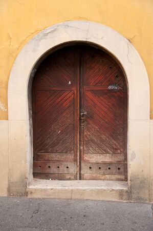 Old wooden door in historical part of Zagreb, Croatia photo