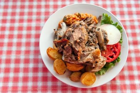 suckling: Traditional roasted pork in Croatian restaurant Stock Photo