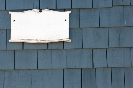 cape cod style: Blank white plaque on tiled wall of New England historic house