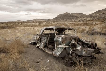 junk car: Old abandoned car in Nevada desert