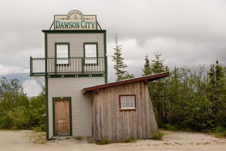 gold rush: Welcome to Dawson city sign on the road