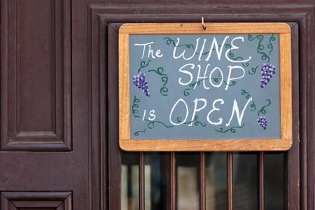 Open sign on wine shop door in St Augustine, Florida photo