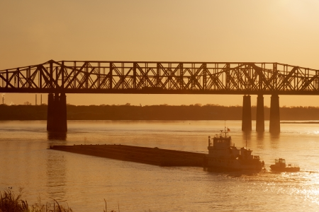 Mississippi river under old railroad bridge in Memphis, TN photo