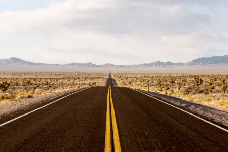 Endless road through Death Valley national park in California Banco de Imagens