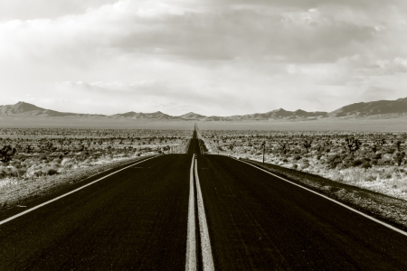soul searching: Endless road through Death Valley national park in California Stock Photo