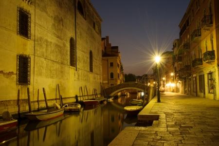 Night scene in Cannaregio, historic residential neighborhood in Venice photo