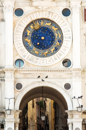 Famous XV century St Marks clock tower on Piazza San Marco in Venice photo
