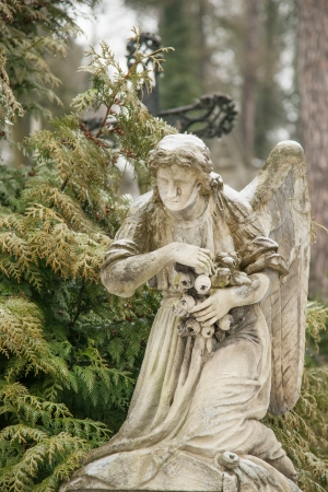 weeping angel: Weeping angel tombstone in famous Lychakiv Cemetery, Lviv Stock Photo