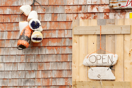 Open sign on craft store in Peggys Cove, Nova Scotia
