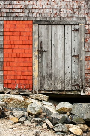 Wooden door on the old house in Peggys Cove, Nova Scotia photo