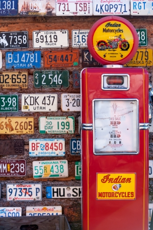 UTAH, UNITED STATES - NOVEMBER 16, 2008  Various old American license plates behind antique gas pump in rural Utah