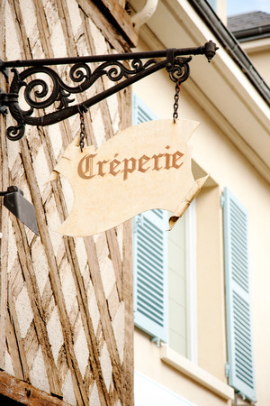 french cuisine: Creperie sign on historic house in Chartres, France Editorial