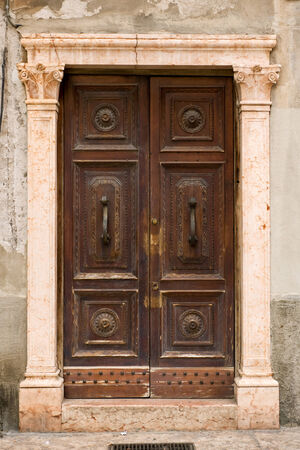 Beautiful medieval door of one of the houses on Via Mazzanti, Verona photo
