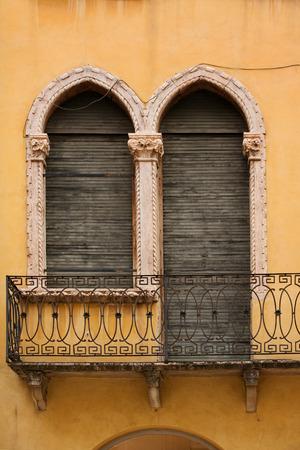 Window and door with balcony in venetian style on Verona street, Italy photo