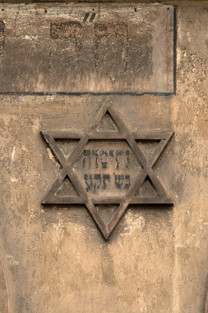 jewish houses: Star of David on the wall of historic Kazimierz, Krakow Stock Photo