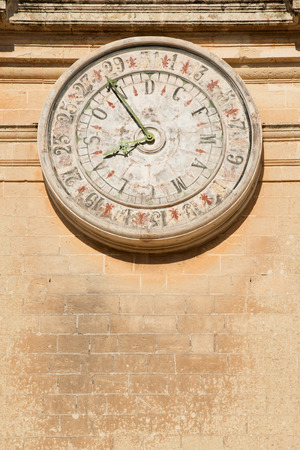pawl: Old calendar on St Paul cathedral in Mdina, Malta