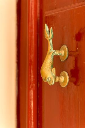 Exquisite door knocker of old Maltese house in Mdina photo