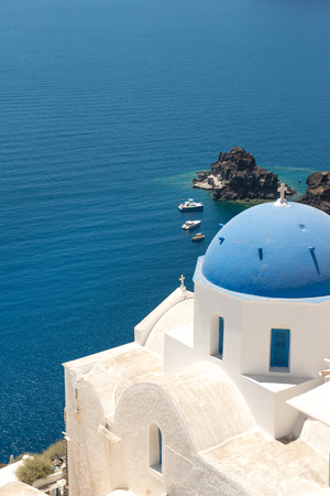 whitewashed: Blue cupola of whitewashed Oia church in Santorini