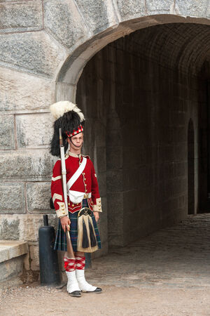 historic site: Halifax, Canada - August 24th, 2010 Guard standing by the gates of Halifax Citadel on August 24, 2008. Guard in historic uniform at Citadel National historic site in Halifax, Canada. Editorial