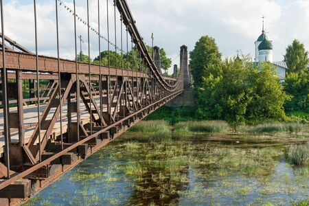 nicholas: St  Nicholas Church and suspension bridge in Ostrov, Pskov region Stock Photo