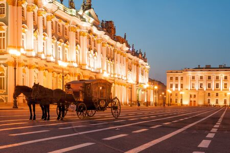 saint petersburg: Horse-drawn carriage by the Winter palace on Palace square Editorial