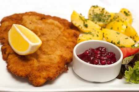 schnitzel: Famous Wiener Schnitzel with side dish in Austrian restaurant
