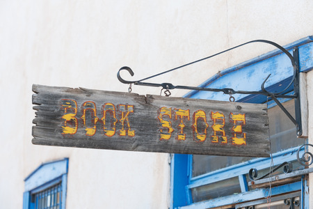 store sign: Crafted book store sign in Taos shopping center Stock Photo