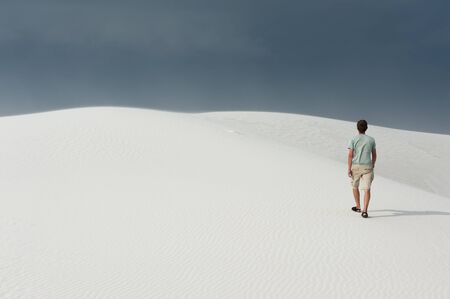 nm: Man hiking in White Sands National monument, NM Stock Photo