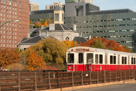 the red line: Red line subway train of MBTA with Boston on background