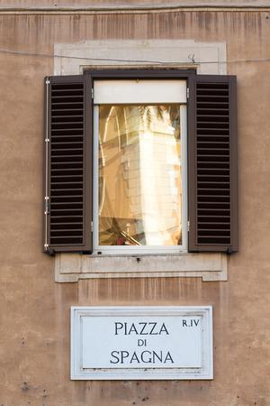 Piazza di Spagna sign on historic italian building in Rome photo
