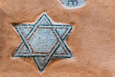 at close quarters: Mosaic of Star of David on the wall of Roman Ghetto house