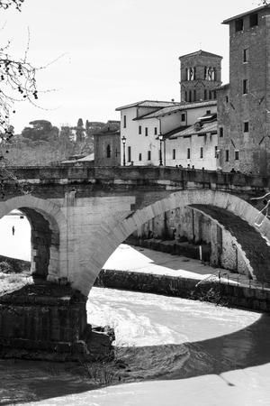 isola: Ponte Fabricius, the oldest bridge in Rome. Isola Tiberina Stock Photo