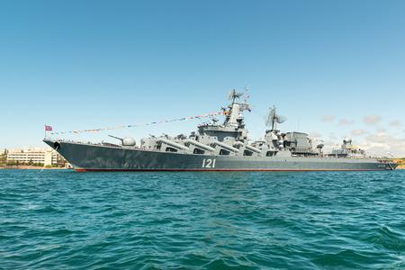 flagship: SEVASTOPOL CRIMEA  MAY 9: Parade of the Russian warships celebrating Victory Day on May 9th 2015. Russian Navy flagship cruiser Moskva in the Sevastopol Bay Crimea