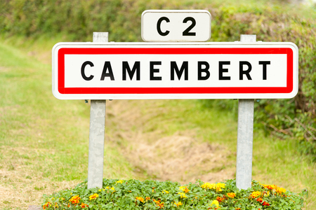birthplace: Town sign of the Camembert village birthplace of famous cheese