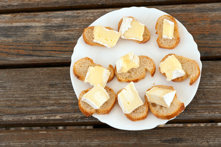 degustation: Degustation plate of famous Camembert cheese in the village in Normandy