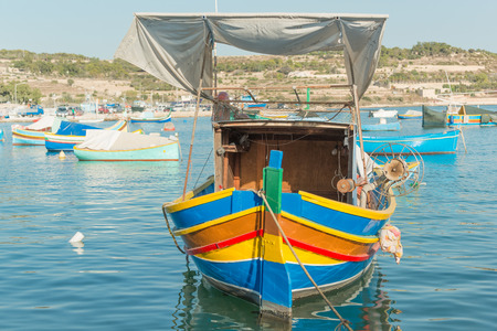 old city: Traditional luzzu boat at Marsaxlokk village Malta