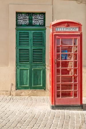 phonebox: Traditional British phone box in Maltese village of  Marsaxlokk