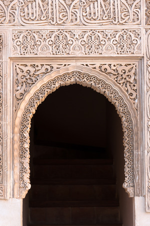 arabian harem: Moorish arch with Arabian script in Alhambra, Granada, Spain