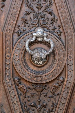 knocker: Ancient door with silver knocker in Granada, Spain Editorial