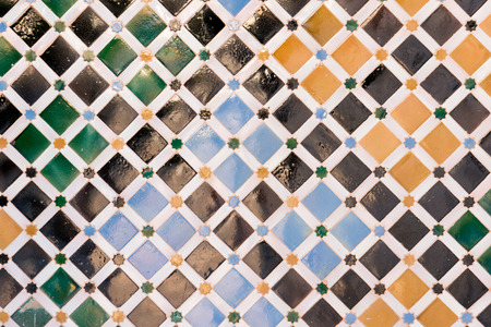 national historic site: Mosaic tiles on the wall of Nazaries palace, Alhambra, Spain Stock Photo