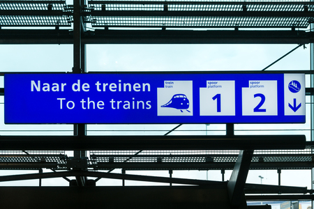 railway transportations: Directional sign to trains in Schiphol International Airport, Amsterdam