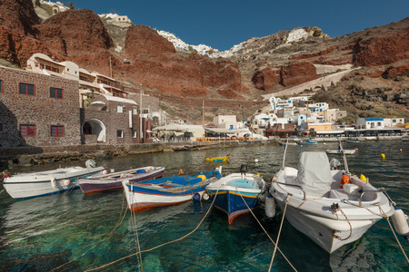 Boats at popular fishing village in Ammoudi Bay in Santorini, Greece Stock Photo