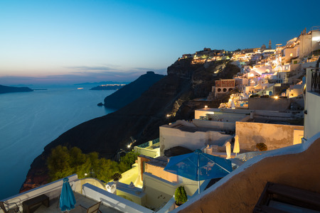 fira: Panorama of traditional terraced houses in Fira, Santorini at dawn Stock Photo