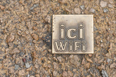 internet search: WiFi sign in French on cobblestone street, France Stock Photo
