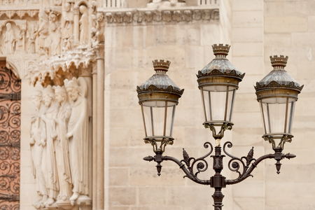 street light: Street light pole seen near Notre Dame Cathedral in Paris, France