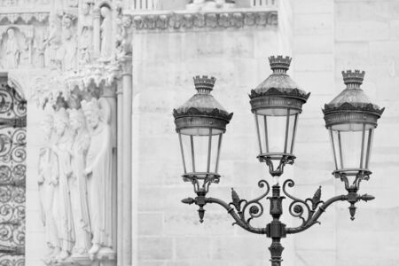 street lamps: Street light pole seen near Notre Dame Cathedral in Paris, France