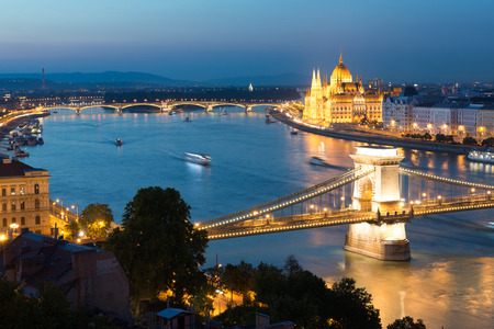 the chain bridge: Night view of Chain bridge and Parliament in Pest part of Budapest, Hungary Stock Photo