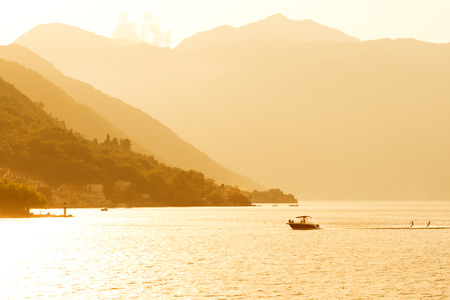 Boat and water skiers in Kotor Bay, Montenegro